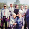 Robert Kreem and Helene Johani  visited Alberta in June 1965 to collect historical material about Alberta\'s Estonian community  and Alberta\'s Estonian pioneers.  Robert Kreem is standing on the far right, Mrs. Johani is kneeling in front.