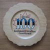 The centenary logo, designed by Janet Matiisen,Calgary, and burned into souvenir plate by Dave Kiil.