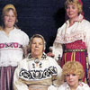 Tiiu Kalev and members of the Koppel family in traditional Estonian folk costumes in 1975  Left to right, standing Myrna and Tiiu Kalev. Sitting Mari Koppel and Lori Kalev.