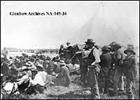 The Honourable David Laird explaining the terms of Treaty #8, Fort Vermilion, Alberta. 1899.