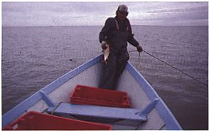 Raymond Ladouceur visiting his nets, Fort Chipewyan, 1985.