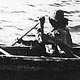 slavey man in canoe