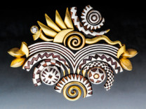 Fireworks Pattern Metal Pin Description: Hand fabricated with cross-section slices of extruded patterns I create with silver or gold and copper, various colors and karats of gold, soldered, etched, sandblasted, oxidized and polished. Dimensions: H:2.25 x W:3.00 x D:0.25 Inches