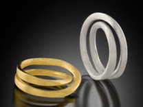 Double Moebius Rings Description: Two rings, one in silver, one in 18KY, carved in wax, cast, hand-finished. Dimensions: H:1.00 x W:1.00 x D:0.50 Inches