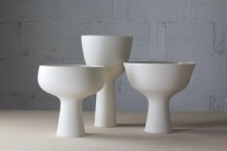 Porcelain Pedestal Bowls Description: Wheel thrown translucent porcelain with glazed interiors and unglazed polished exteriors. Set of 3 Pedestal Bowls. Dimensions: H:17.00 x W:30.00 x D:20.00 Inches