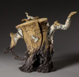 Charred Split Log Birch Teapot Description: Wheel thrown, hand-built and hand carved stoneware with stains, washes and oxides. Fired to Cone 5 in oxidation. Dimensions: H:15.00 x W:18.00 x D:8.00 Inches
