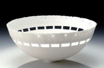 Orchard Description: Wheelthrown, hand carved and cut cone 10 porcelain. Unglazed to emphasize translucency. Dimensions: H:5.00 x W:11.00 x D:11.00 Inches