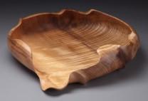 Morphed Bowl Description: myrtlewood - carving Dimensions: H:2.80 x W:11.00 x D:12.00 Inches