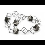 Necklace - Chorus Description: Fabricated in three different sized sterling silver wire cubic forms. The smallest cubes are covered in calligraphied hand stitched silk fabric and then lacquered for both beauty and durability. Dimensions: H:9.50 x W:9.50 x D:1.50 Inches