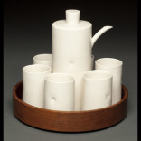 sake set with teak tray Description: handbuilt cone 6 porcelain with vintage teak tray, one of a kind Dimensions: H:9.00 x W:8.00 x D:8.00 Inches