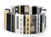 sel de mer 1x4 bracelet Description: bracelet made from repurposed LEGO, patinated and textured sterling silver, Argentium silver, rubber cording Dimensions: H:1.25 x W:4.00 x D:0.31 Inches