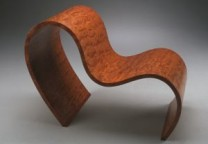 Ribbon Chair Description: Bubinga and bending ply vacuum formed. Dimensions: H:30.00 x W:20.00 x D:36.00 Inches