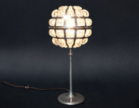 Dandelion Lamp Description: This lamp is made of cast bronze, fabricated copper and blown glass.  Once finished, I nickel plate it.  The blown glass bulging through the cutouts acts as lenses, magnifying the light coming from the lamp. Dimensions: H:18.00 x W:8.00 x D:8.00 Inches
