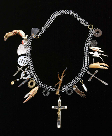 Robert Ebendorf, Lost Soul, Found Spirit, 1996 mixed media: paint on metal, pearls, squirrel's foot, glass, crab claws, metal and wood crucifixes, metal fountain pen tip, chicken's foot, metal, ink on paper under plexi in metal, on a metal chain 13 x 12 x 1 ¼ inches Smithsonian American Art Museum Gift of the artist in memory of Mr. Ronald H. Pearson 1996.61. Used with permission.