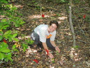 Photo of Melissa McCormick working in the field.