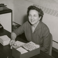 Bonnie Cone photographed at her desk, January 27, 1958