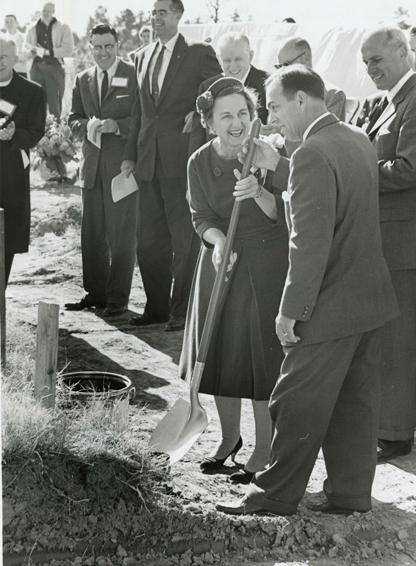 Bonnie Cone raises a shovel at the groundbreaking ceremony for Charlotte College, November  21, 1960
