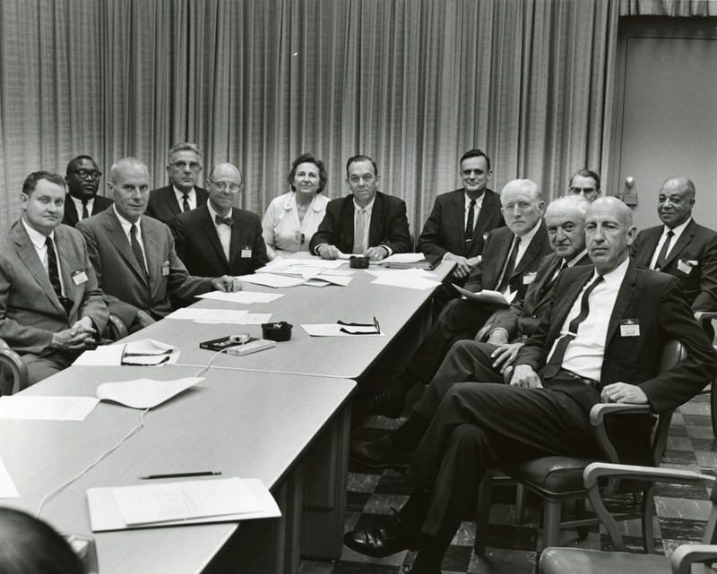 Charlotte College Board of Trustees seated at a table, June 27, 1963