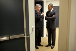 President Barack Obama and Prime Minister Stephen Harper of Canada talk backstage at the South Court Auditorium in the Eisenhower Executive Office Building following their joint press conference, Dec. 7, 2011. (Official White House Photo by Pete Souza)