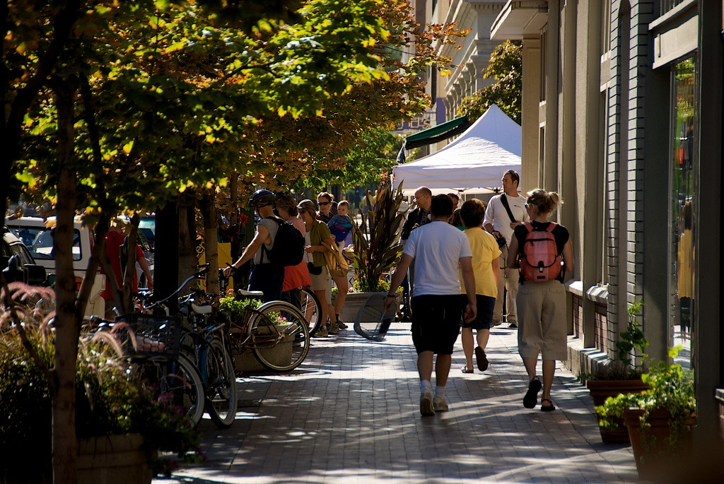 Shade trees promote walking. They humanize streets and clean the air. Pictured: Boise's shaded Saturday market, Bannock at 8th.