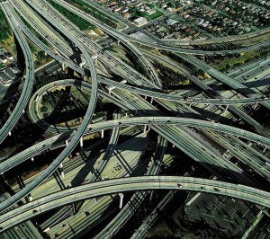 Freeways. Designed to expedite traffic, freeways increase the value of car-dependent suburban land as they aggravate housing spawl. When suburban commuters, braking and accelerating, compete for the open lanes, demand exceeds capacity.