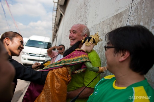 "Derek Nicholls, Captain of the Rainbow Warrior receives a warm welcome from a Thai puppet during the launch of the Greenpeace ""Turn the Tide"" tour in Bangkok Port on September 17, 2010"
