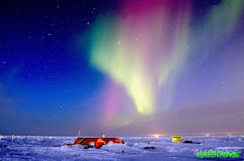 Aurora Borealis over Greenpeace protest against oil drilling by BP in the Alaskan Arctic.