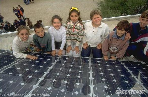 Schoolchildren from Gourdouros, Crete, Greece, with installed solar panels at their school.