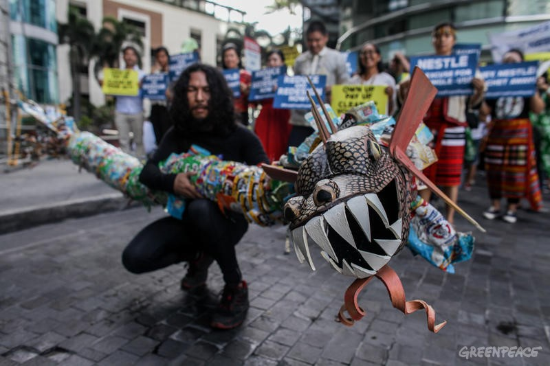 Accompanied by a serpent-like plastic monster, environmental activists display placards as they troop to Nestle's Philippine headquarters in Manila, Philippines demanding accountability for their role in abetting the country's plastic pollution crisis on Wednesday. April 10, 2019. Nestle was named one of the worst plastic polluters after cleanups of plastic waste around the world in 2018.