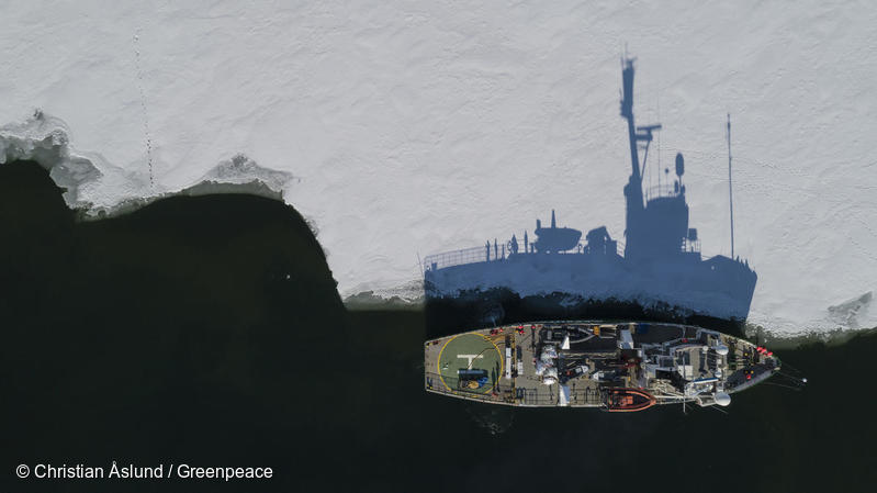 Aerial view of Greenpeace ship the Arctic Sunrise mouring at the ice in Tempelfjorden on Svalbard.