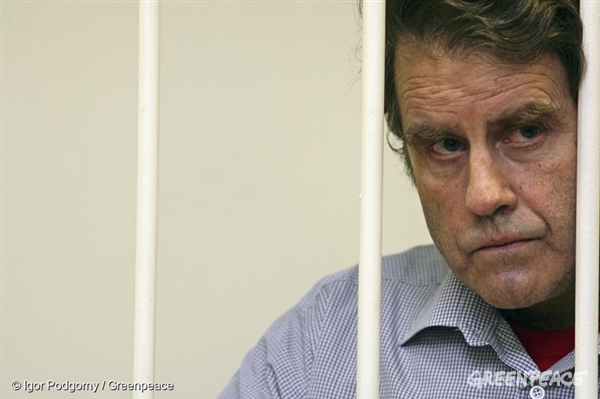 Peter looks on from his cell during hearings in St. Petersburg, Russia.
