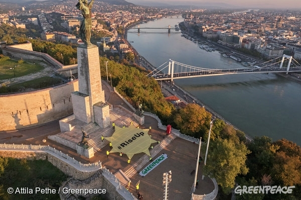 Greenpeace activists display a huge sun with the text #RiseUp under the Liberty Statue in Budapest and create a spectacular view from above to remind European leaders of their commitment to the Paris Agreement to promote renewable energy and tackle climate change.