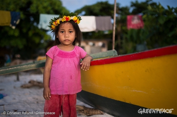 A young girl in the fishing village Te O Ni Beeki on Tarawa Island, Kiribati. The Pacific island nation is considered one of the least developed and poorest countries in the world, with their livelihood and survival challenged from the threats of climate change and overfishing.