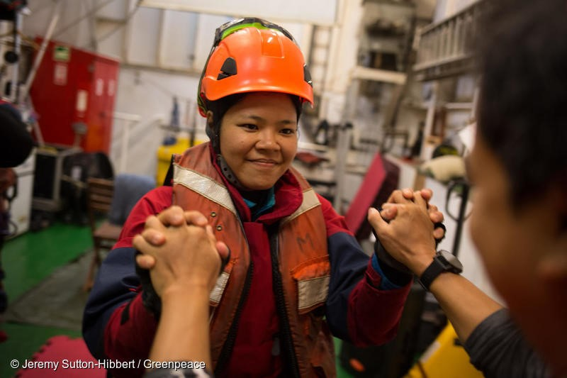 Atlantic Ocean, on 17 November 2018.  - Activist Waya prepares to leave the MV Esperanza to begin their boarding action on a giant tanker ship carrying dirty palm oil from Indonesia to Europe in a peaceful protest against rainforest destruction.Trained Greenpeace climbers from Indonesia, Germany, the UK, France, Canada and the US, have safely scaled the side of Stolt Tenacity and aim to stay on board until it arrives at its final destination in Rotterdam.The 185-metre long cargo ship is loaded with palm oil from Wilmar, the largest and dirtiest palm oil trader in the world.