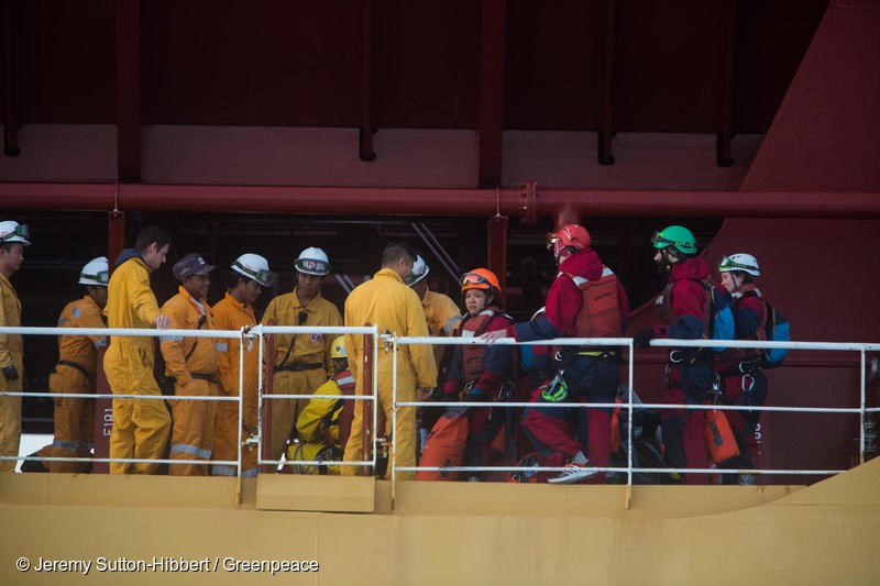 Atlantic Ocean, on 17 November 2018.  - Crew members of the Stolt Tenacity tanker ship confront six Greenpeace activists who boarded the giant tanker ship carrying dirty palm oil from Indonesia to Europe in a peaceful protest against rainforest destruction.Trained Greenpeace climbers from Indonesia, Germany, the UK, France, Canada and the US, have safely scaled the side of Stolt Tenacity and aim to stay on board until it arrives at its final destination in Rotterdam.The 185-metre long cargo ship is loaded with palm oil from Wilmar, the largest and dirtiest palm oil trader in the world.