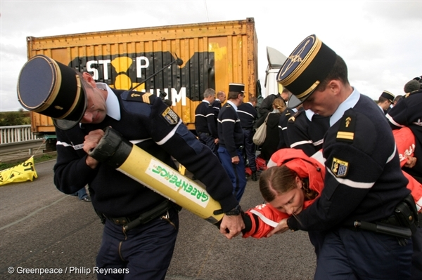 Greenpeace activists clash with French police during a protest against the imminent arrival of two BNFL (British Nuclear Fuels) ships, which are carrying 140kg of radioactive weapons-grade plutonium (2004).