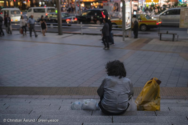 Homeless man in Tokyo, October 2018. United Nations human rights Special Rapporteurs in 2018 called for urgent action by the Japanese government over reports of widespread exploitation of workers conducting decontamination work in Fukushima prefecture, including reports of recruitment of homeless people, asylum seekers, and foreign technical trainees. More than 70,000 decontamination workers have been employed in areas of Fukushima during recent years, some earning as little as 20 dollars a day. The Governments decontamination program, involving hundreds of sub contractors, has been estimated to cost from 4-5 trillion yen to as much as 30 trillion yen (271 billion dollars). Yet 70% of Fukushima is mountainous forest that cannot be decontaminated. Christian Aslund/Greenpeace