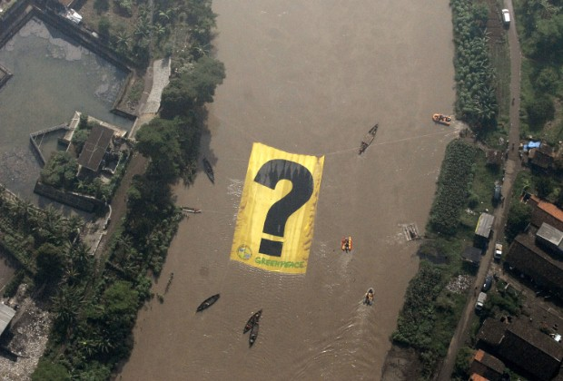 "Greenpeace activists unfurled a banner ""?"" at Citarum river, Bangung, West Java, Tuesday, May 3rd, 2011"