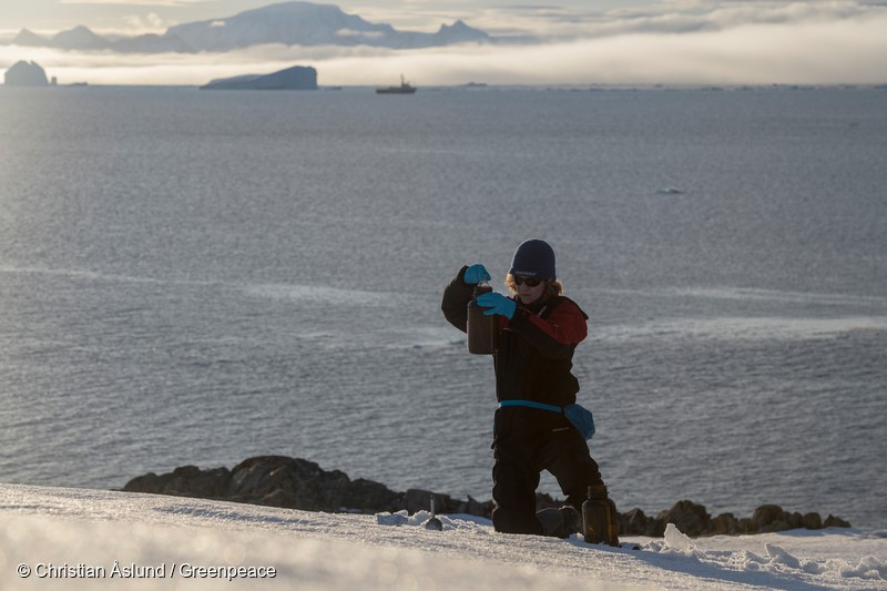 Madder Cliffs, Joinville Island. Antarctica.Sandra Schoettner, marine biologist and oceans campaigner with Greenpeace Germany and Josh Ingram from Greenpeace ship Arctic Sunrise doing snow sampling to investigate the presence of persistent organic pollutants like PFCs (per- and polyfluorinated chemicals) in the Antarctic environment. PFCs are widely used in industrial processes and products. The outdoor industry applies them for waterproof gear like jackets and shoes. Greenpeace has already performed this kind of sampling in other remote and seemingly pristine places in China, Russia, Turkey, Scandinavia, the Alps, and Patagonia.