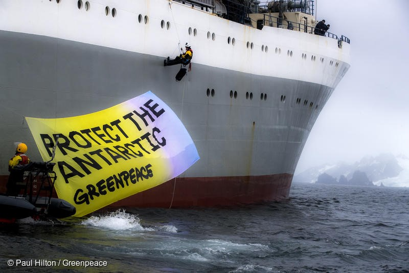 "Greenpeace activists in peaceful protest, displaying a banner saying ""Protect the Antarctic"" on the Ukrainian krill trawler 'More Sodruzhestva' in the Bransfield Strait near Greenwich Island, Antarctic, 22nd Marech 2018.  Greenpeace is calling for the krill industry to commit to stop fishing in any area being considered by governments for ocean sanctuary status, and to back proposals for marine protection in the Antarctic. Photo: Paul Hilton / Greenpeace"