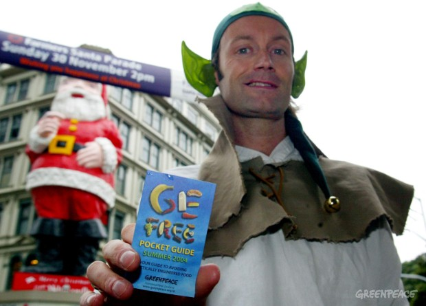 Greenpeace activists dressed as Christmas elves