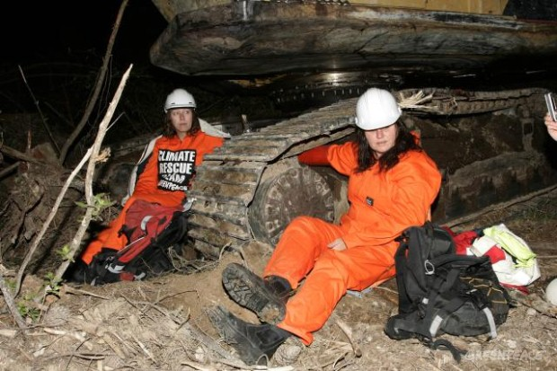 2 Greenpeace activists locked on to logging equipment in Kinleith Forest