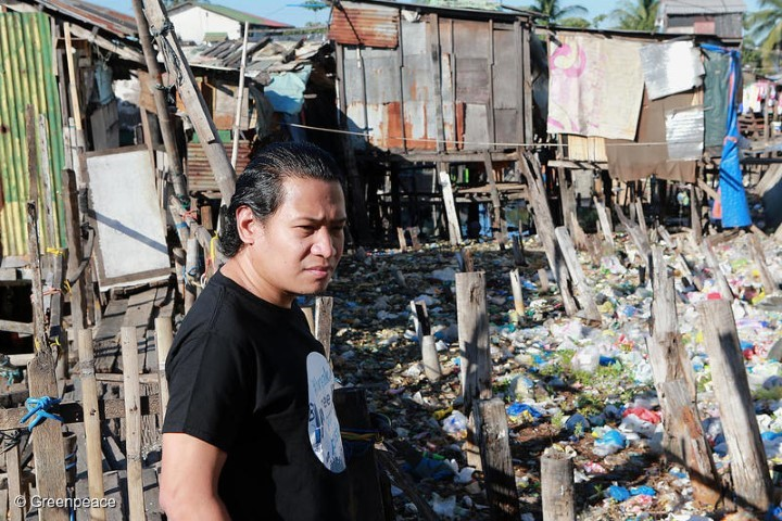 GAIA Philippines Executive Director Froilan Grate stands looks at a trash-filled river where a community of underprivileged residents live in Barangay Bagumbayan North in Navotas City, Philippines.