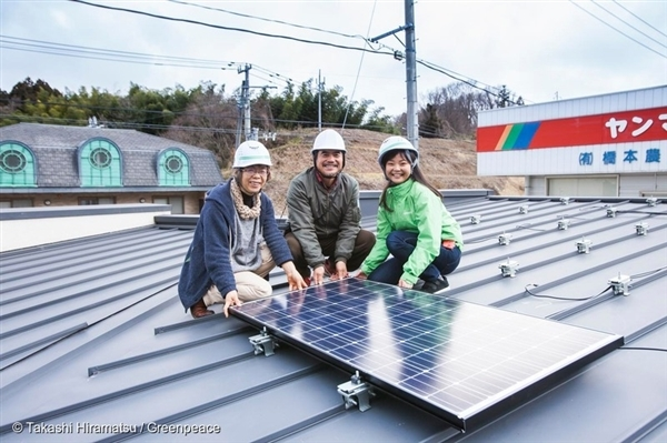 Mr and Mrs Okagawa and myself help install the first photovoltaic panels…