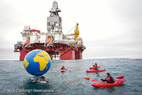 Globe with messages from people around the world urging the Norwegian government to end its Arctic oil expansion. 17 Aug, 2017  © Nick Cobbing / Greenpeace