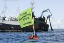 Greenpeace activists take direct action for