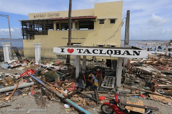 A family takes refuge in Tacloban City, Philippines, the place that was most severely impacted by Typhoon Haiyan in 2013