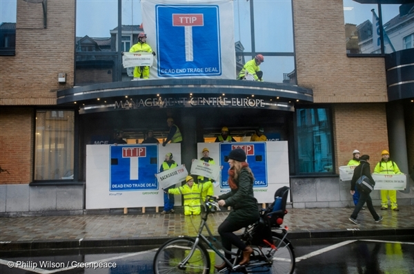 Greenpeace activists block EU and US negotiators from TTIP Talks in Brussels. The protesters warn that the TTIP is a threat for democracy, environmental protection, health standards and working conditions.
