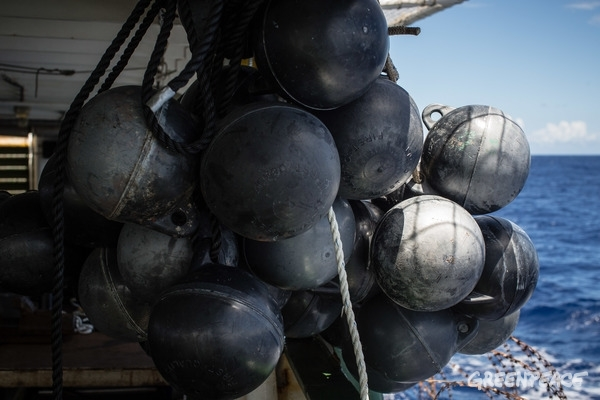 Greenpeace Esperanza Indian Ocean 2016, Buoyes collected from recovered FADs hang on the poop deck.  © Will Rose / Greenpeace