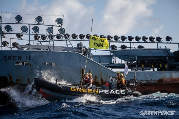 Greenpeace Activists confront supply vessel Explorer IIActivists on board the Greenpeace ship Esperanza peacefully confront marine operations at the heart of Thai Union's supply chain, the latest in a series of global protests against the tuna giant's destructive fishing practices. At 06.00 local time, activists in inflatable boats deliver a cease and desist letter to the deck of the Explorer II, a supply vessel using an underwater seamount to perch on and contribute to massive depletion of ocean life.  © Will Rose / Greenpeace